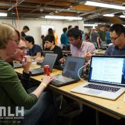 Students work on their laptops in the Idea Forge during Hack CU 2015.