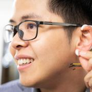 Tam Vu modeling a prototype of an 'earable' device