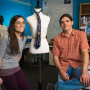 Halley Profita and Dana Hughes stand next to a mannequin in their lab.