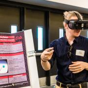 A student demonstrates a VR project during the 2018 expo.
