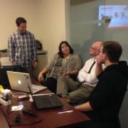 Students discuss a big data project with Zayo staff members.