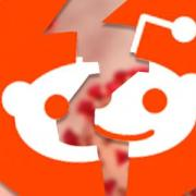 A shattered Reddit logo with coronavirus molecules in the background