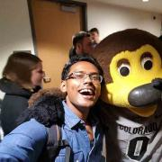 A selfie of Gupta with Chip the buffalo mascot.