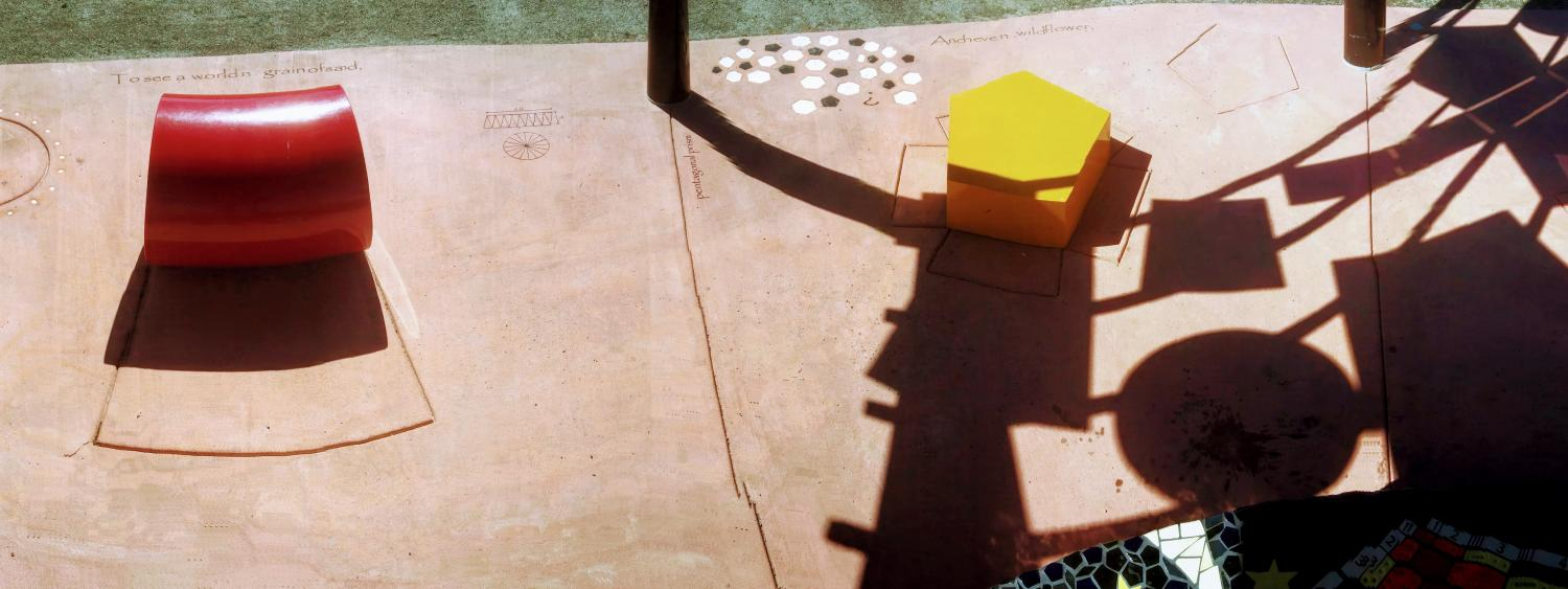 panorama of red cylinder, yellow pentagon and shape shadows from the roof.
