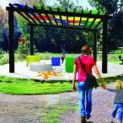 Geometry Park, a mother and daughter walk towards a multi-colored installment in the center of the park