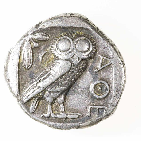 silver coin depicting owl
