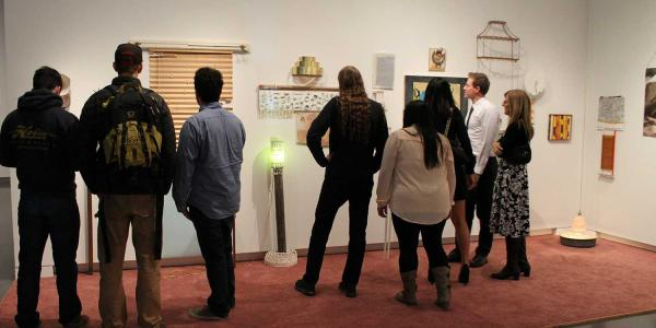 a group of adults looks at an art installation