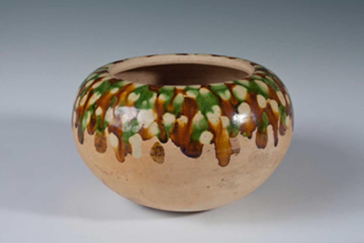 ancient ceramic bowl with brown and green glazing