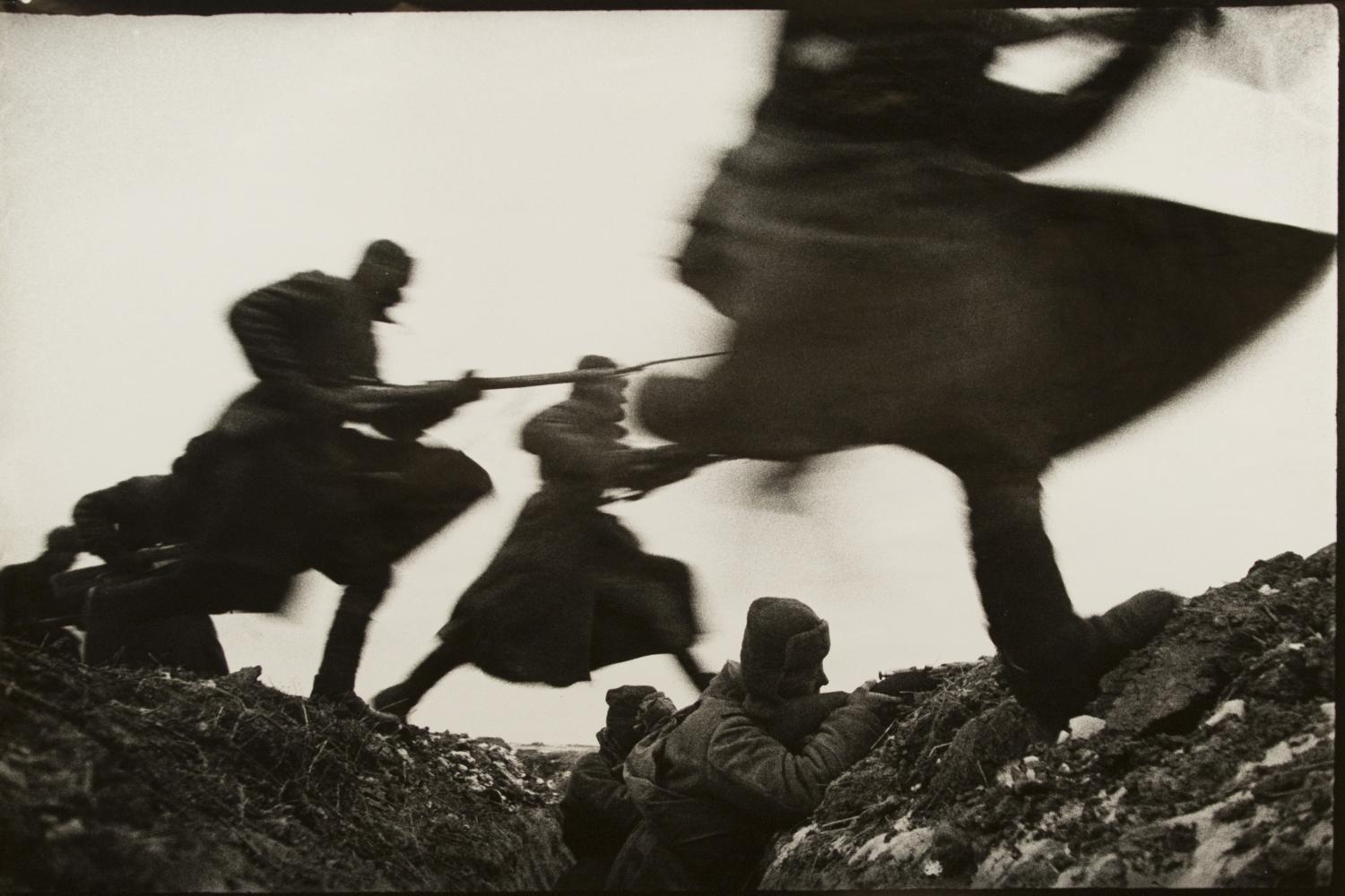 black and white image of soldiers running