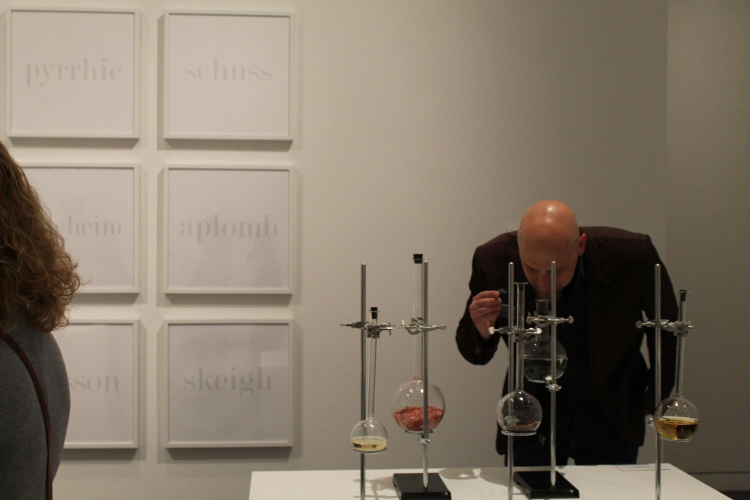 A man looks at a scientific instrument that's part of an art installation.