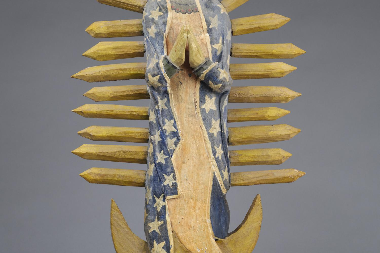 Painted wooden figure of our lady of Guadalupe