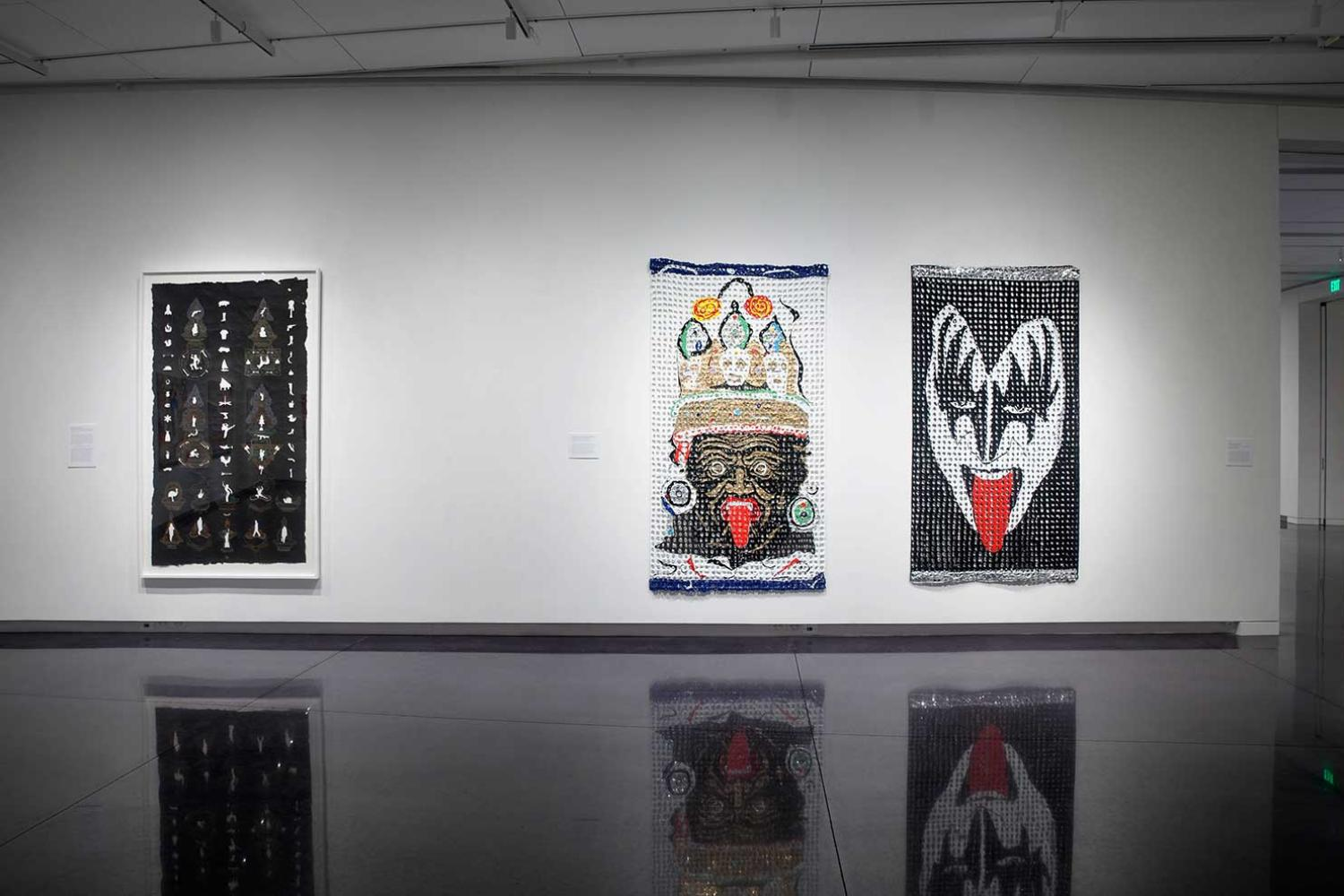 Installation view of three large artworks hung together