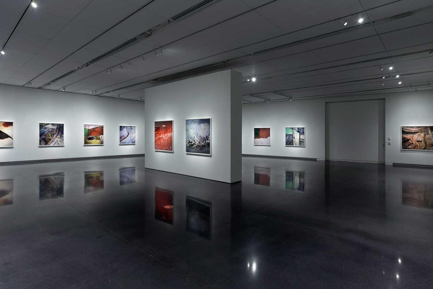 photo of the gallery with large colorful photographs on the walls