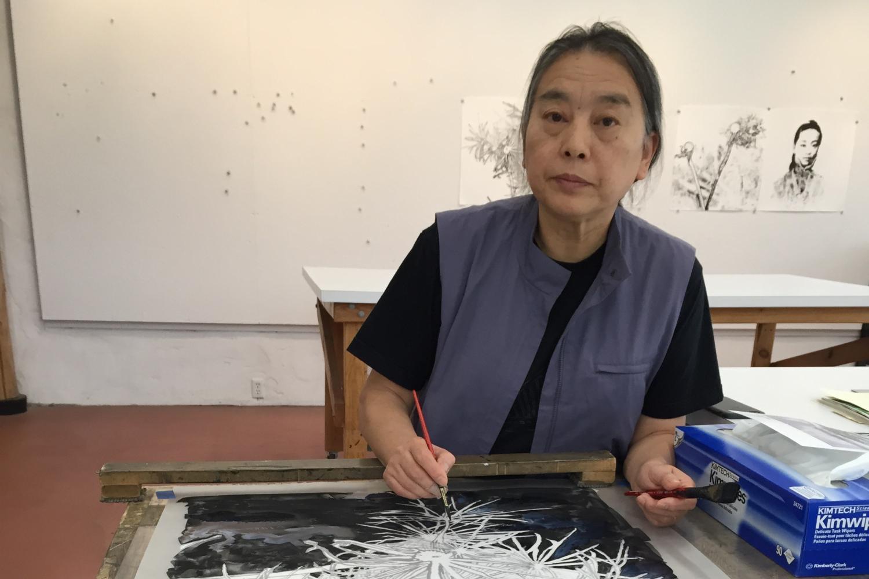 Hung Liu at work in the studio
