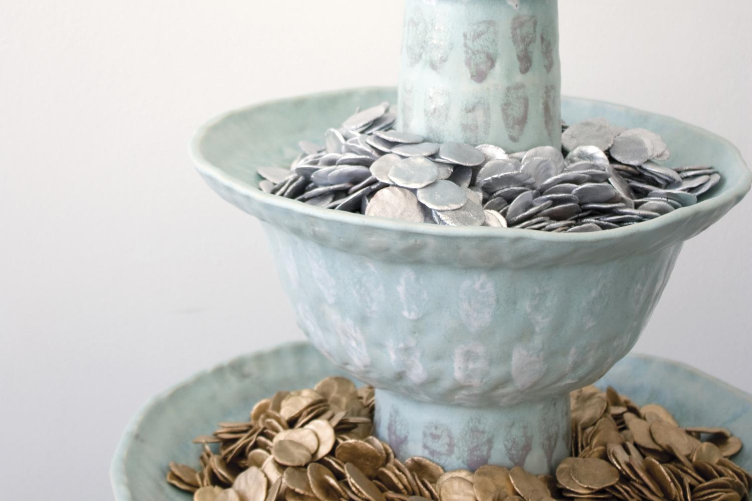 Ceramic fountain filled with ceramic coins.