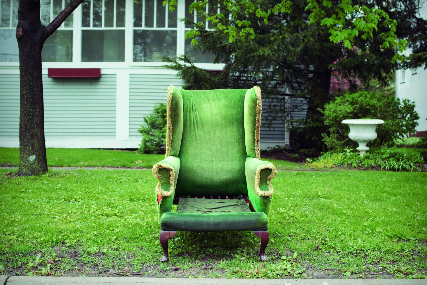 Photograph of a green chair in a driveway