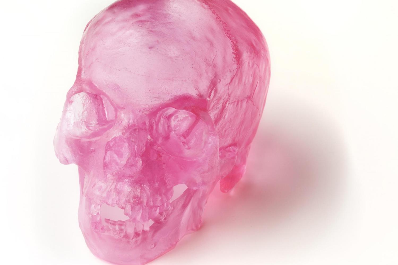 a pink glass human skull