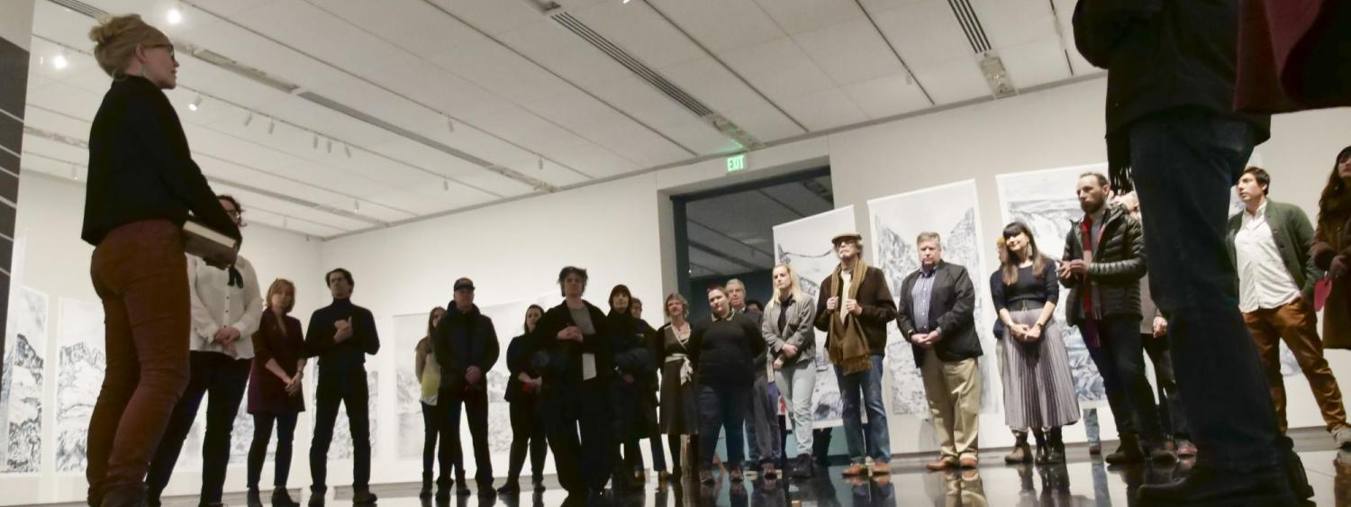 People gathered in an exhibition gallery