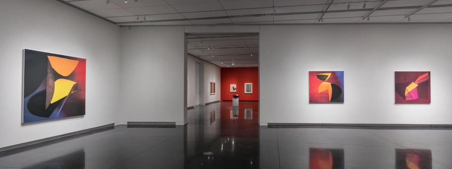 Photo of the inside of the CU Art Museum galleries with artwork on the walls and on pedestals.