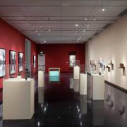 installation view of exhibition featuring scholar's rocks and hung works