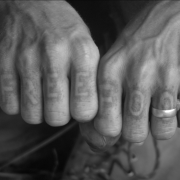 a black and white photo pf a person's hands pressed together in fists