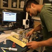 team member working on satellite prototype
