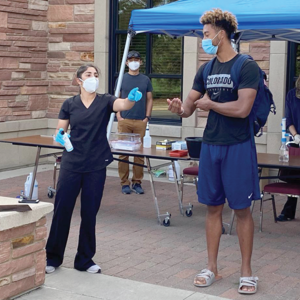 nurse and student at hygiene station