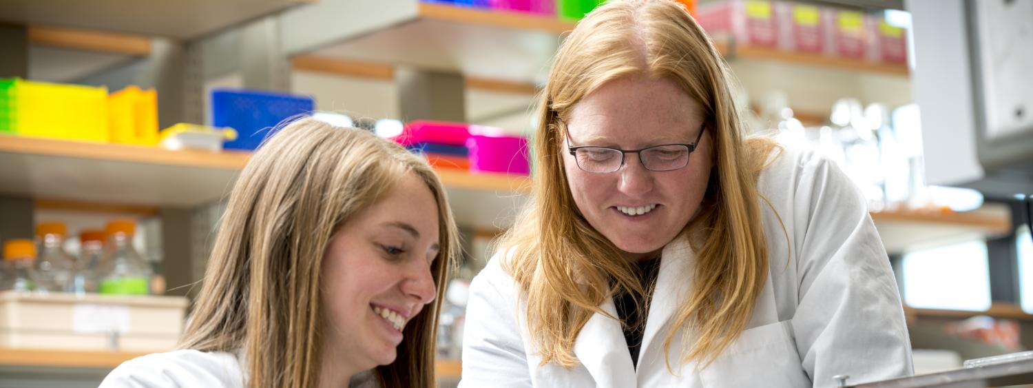 Kristi Anseth working in her lab with a student