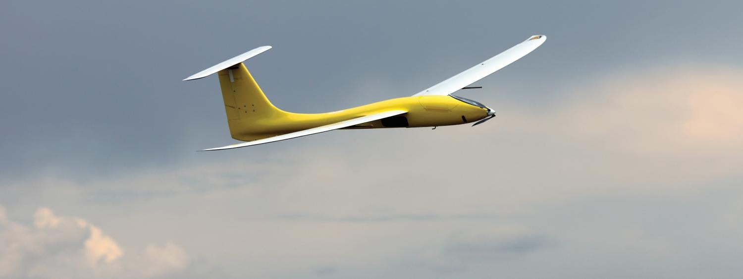 CU drone, yellow, flying in the sky