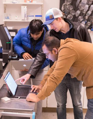 The team performs penetration testing on a gene sequencing machine at Colorado State University.