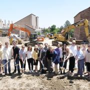 Group of students at the groundbreaking of the construction to connect the business and engineering buildings of the CU Boulder campus
