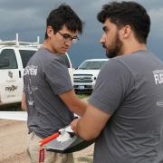 CU Boulder students hold a drone while researching severe weather