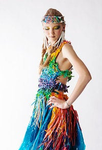 Girl in dress made from recycled materials