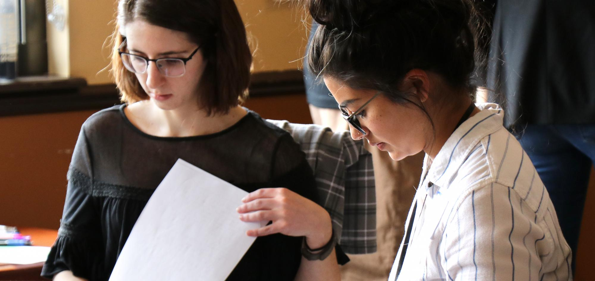 Students reviewing papers