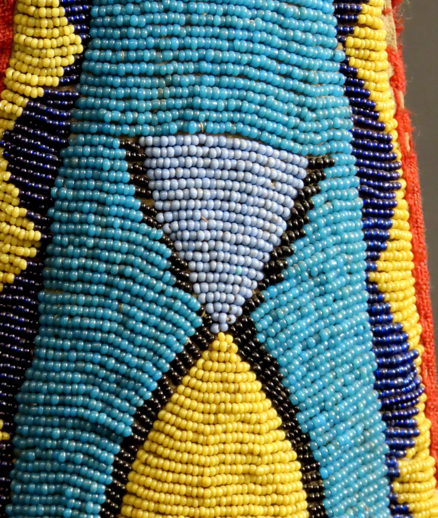 leather with beaded decoration in blue, yellow and reds