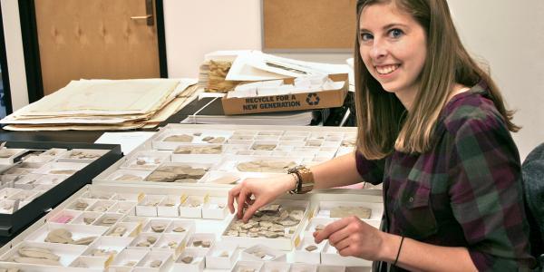 student examining specimens