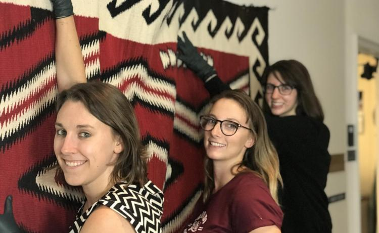 Students hanging textile