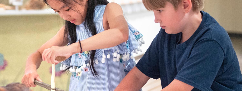 Girl holding artifact