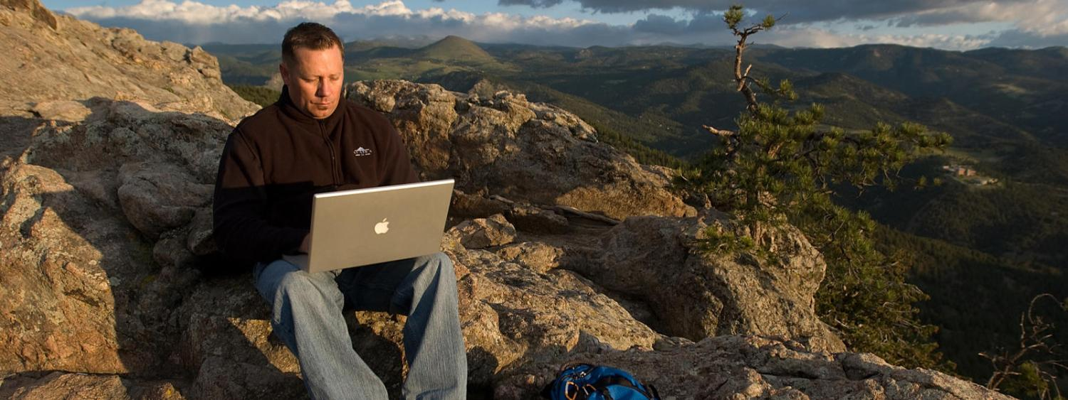 student studying on mountainside