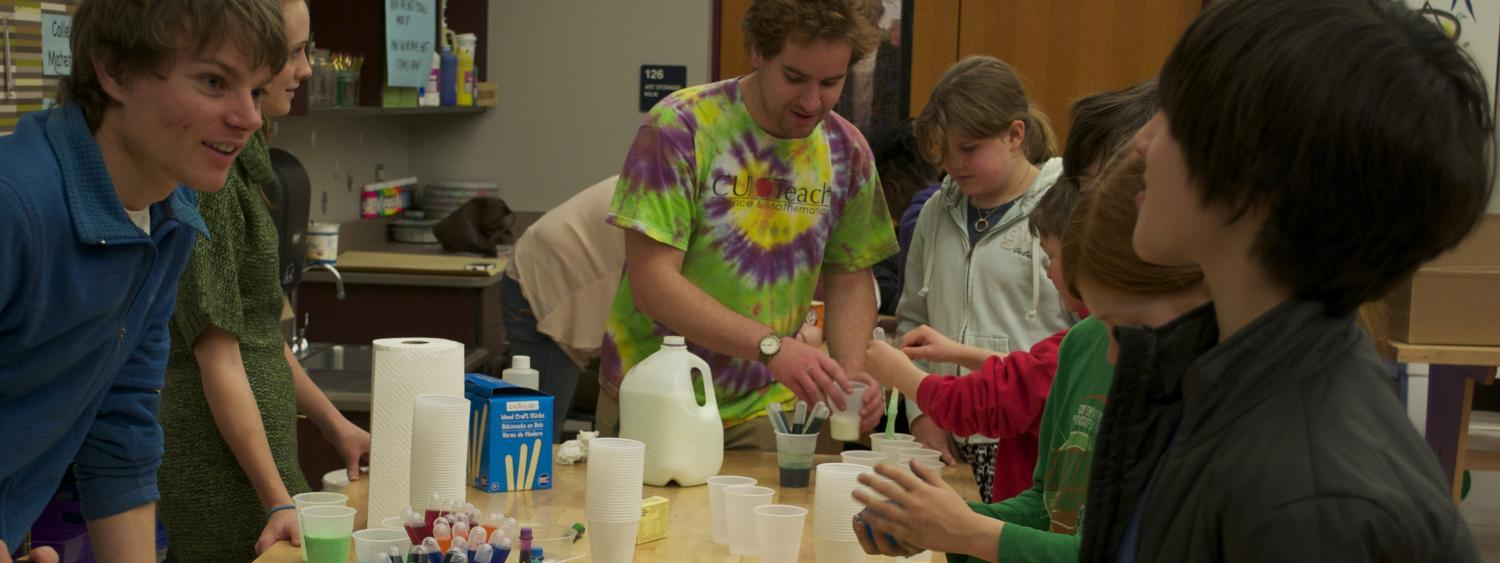 CU Teach students and kids work on tie dye chemistry lesson