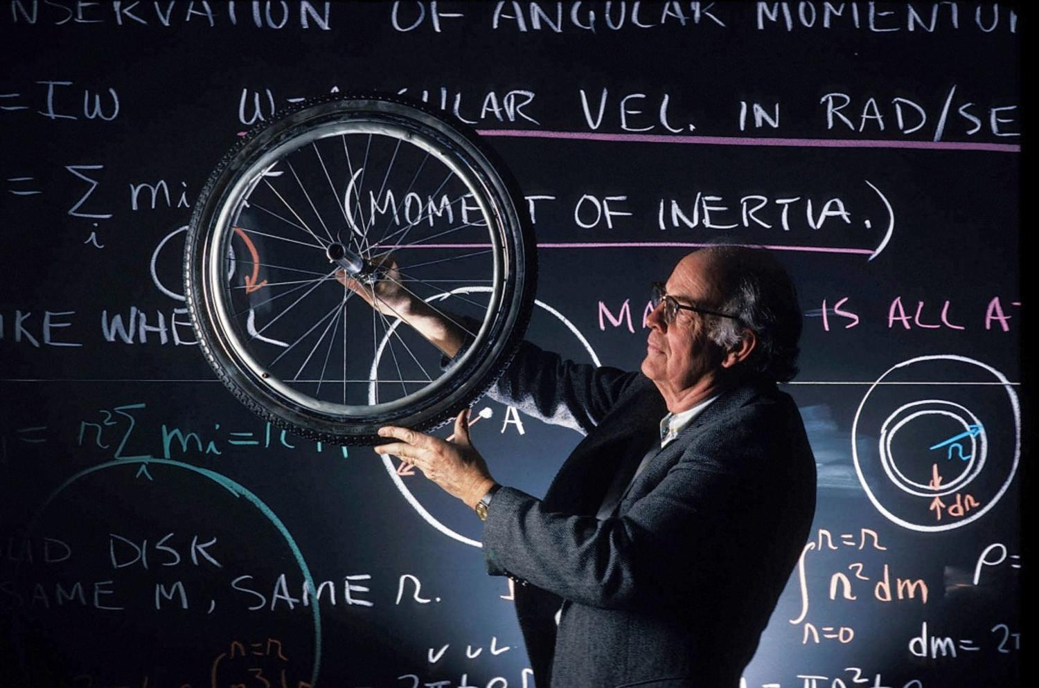 Professor in the classroom in front of a blackboard