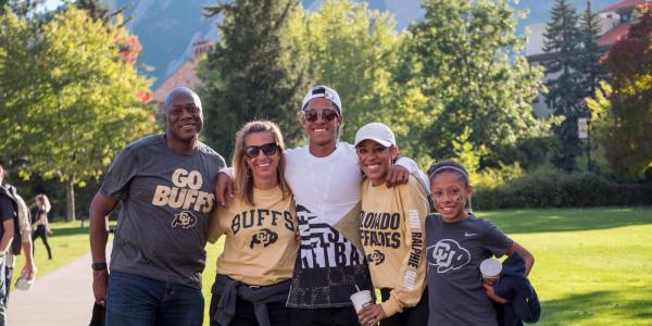 a family at CU Boulder in CU gear