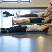 a class of students doing pilates