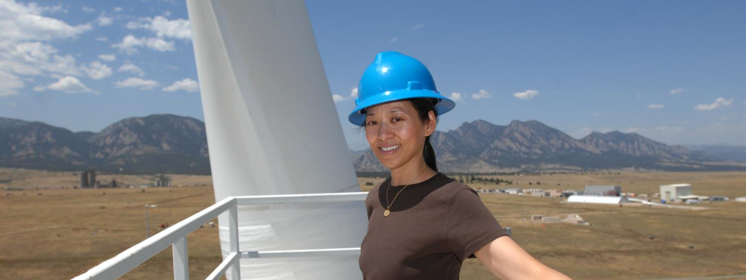 Lucy Pao stands atop a wind turbine at NREL