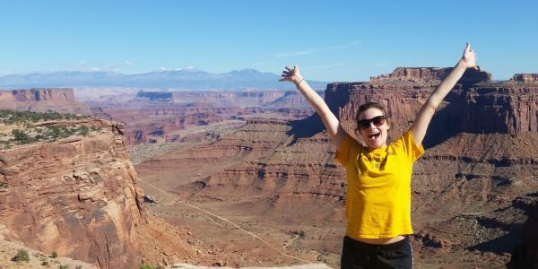 Hannah expressing herself in font of the grand canyon