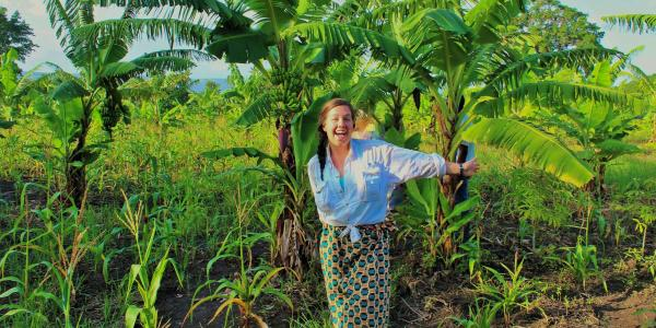 Saunders gestures toward a stand of banana trees.
