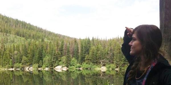 Gabbert surveys a tranquil lake.