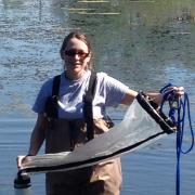 Elizabeth in water fishing for zooplankton