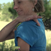 Carol Kerns with a honey bee on her back