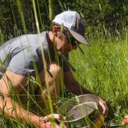 Noah Fierer sampling in a field